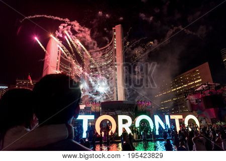 TORONTO - July 25 2015: Firework over City Hall at Nathan Phillips Square during 2015 Pan American Games. Toronto Ontario Canada.