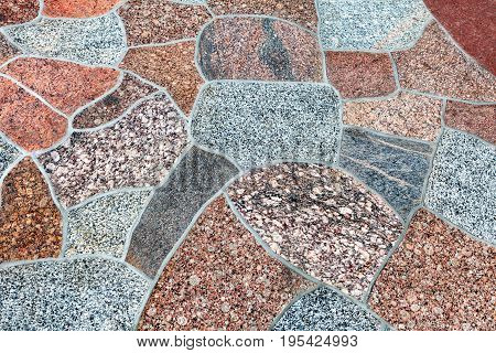 Surface of polished colored granite. Footpath pavement of granite