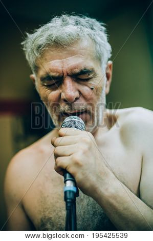 Behind Scene. Famous Alternative Male Singer Practice Singing On Microphone