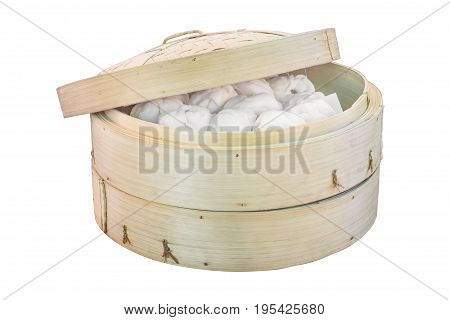 Chinese dumpling in a bamboo steamer boxisolated on white background with clipping path.
