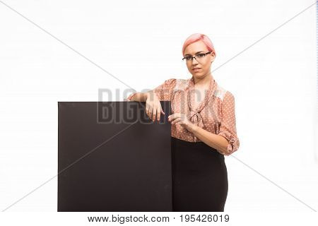 Young happy woman portrait of a confident businesswoman showing presentation, pointing placard background. Ideal for banners, registration forms, presentation, landings, presenting concept.