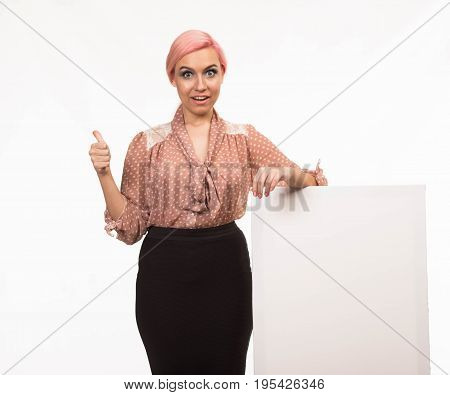 Young glad woman portrait of a confident businesswoman showing presentation, pointing placard background. Ideal for banners, registration forms, presentation, landings, presenting concept.