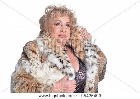 Senior woman in fur with necklace on white background