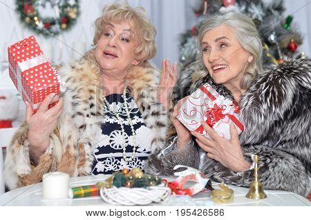 Senior women packs the gifts on Christmas and laughing