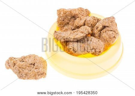 Dry food in bowl for large breeds of dogs. Studio Photo