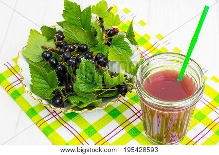 Useful vitamin fresh juice in glass on wooden table. Studio Photo