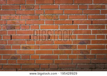 View on a red Brick Wall with Silhouette. Close-up of a red Wall. Natural Background. Stone Pattern