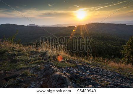 Sun near the earth. Sunlight falling on rock. Ingenuous sunrise.