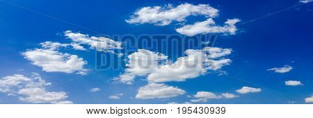 Isolated white clouds on blue sky. Set of isolated clouds over blue background. Design elements. White isolated clouds. Cutout extracted clouds.