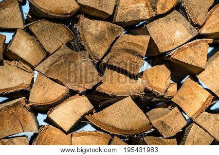 Pile Of Wood Logs Ready For Winter. Wood Logs Texture Background