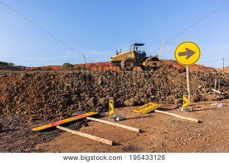 Construction industrial earthworks landfill compactor machine vibration leveling sand stones landscape