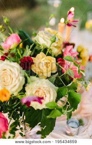 celebration, decoration, wedding, floral design, gardening concept - bright multicolored bouquet of creamy avalanches, yellow roses, beautiful peonies and marasala colored carnations
