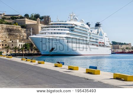 Valletta, Malta - June 4 2017: Cruise Seabourn Odyssey anchored in the harbour of Valletta at the old seawall.