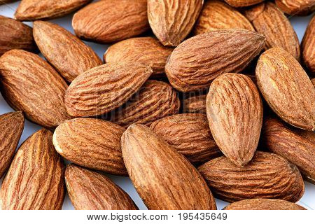 many walnut almonds on white background close-up