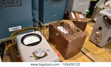 Antique Equipment with leather cases arranged on a work bench