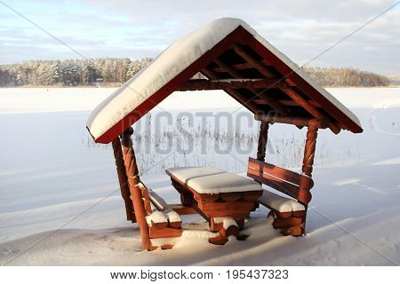 Pavilion on the shore of the winter lake