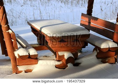 Snow on the table and the benches