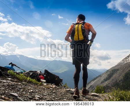 Man trail running in the mountain in Altai, Russia.