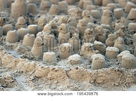 Simply constructed sandcastles in the setting sun.