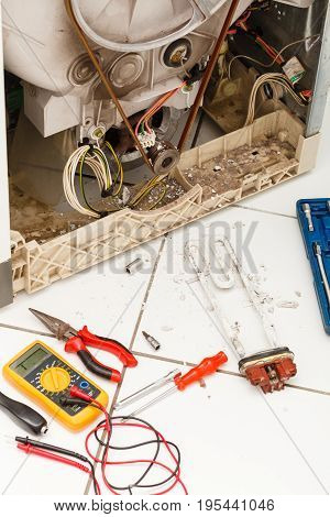 Machine industry repeair mechanical concept. Tools with washing machine. Broken laundromat with parts and tool set.