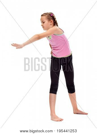 Young girl standing and doing stretching and flexibility gymnastic exercise - isolated