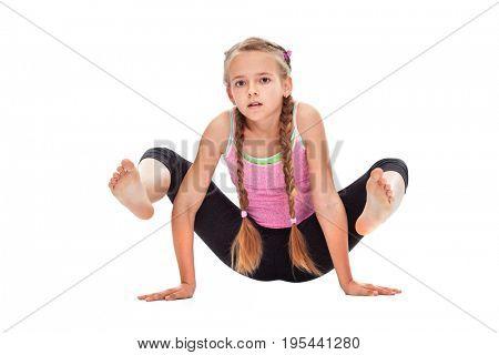 Young girl doing gymnastic exercise - isolated