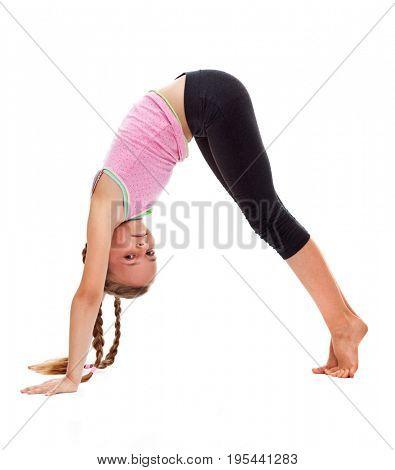 Young girl doing gymnastic floor exercises - isolated