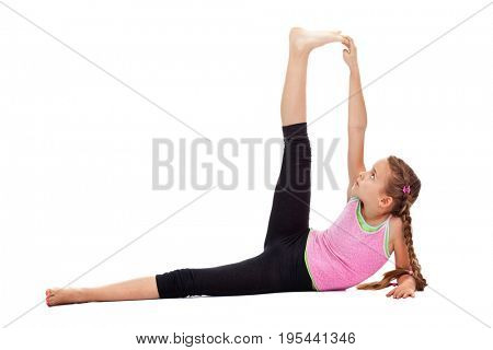 Young girl doing stretching and flexibility exercises - side view, isolated