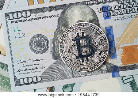 Photo of dollars with silver bitcoin