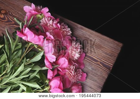 Beautiful bouquet with fragrant peonies on wooden table
