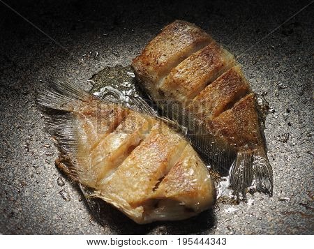 oily fried fish in pan not good for calories control