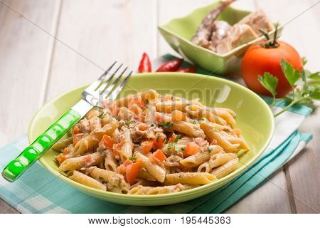 pasta with tuna anchovies tomato and hot chili pepper, selective focus