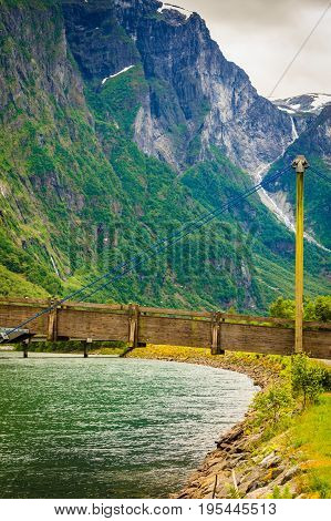 Norway Natural Mountain And Old Wooden Bridge.