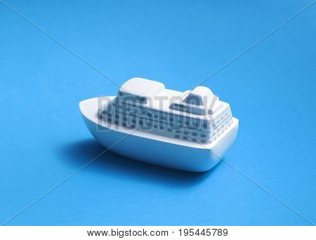 Toy ship on blue background