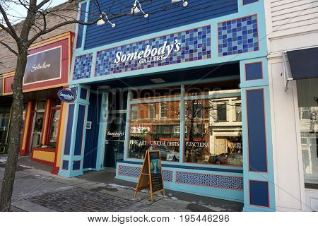PETOSKEY, MICHIGAN / UNITED STATES - NOVEMBER 22, 2016: One may purchase fine art, jewelry, unique gifts, and functional art at Somebody's Gallery, on Lake Street in downtown Petoskey.