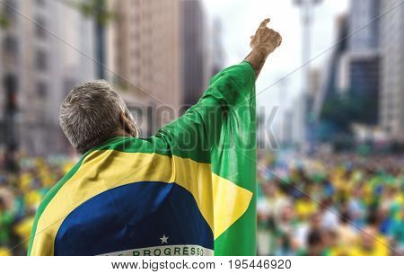 Brazilian senior holding the flag in Sao Paulo