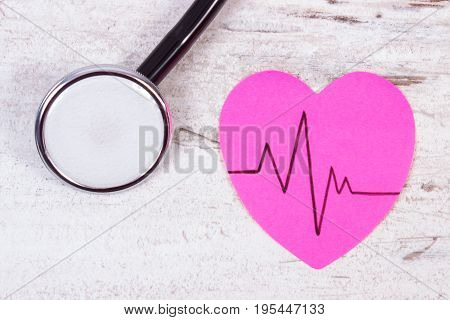 Heart Of Paper With Cardiogram Line And Stethoscope On Old Board, Medicine And Healthcare Concept