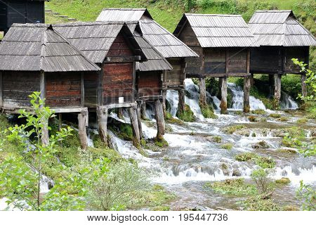 Wooden huts housing the traditional watermills at Pliva Lake Jajce Bosnia and Herzegovina