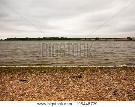 Textured Layers Of A Sea Shore Overcast And Waves, Sand And Pebbles