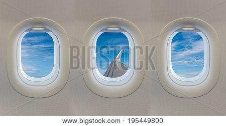 window on airplane with blue sky .