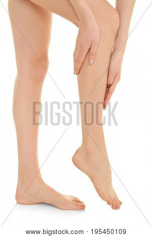 Young woman suffering from pain in leg on white background. Concept of orthopedist