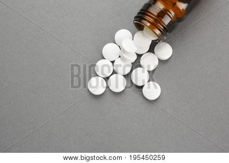 Health care concept. Pills and jar on grey background