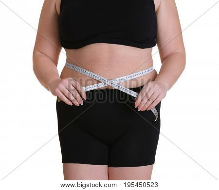 Stout adult woman with measuring tape on white background. Weight loss concept