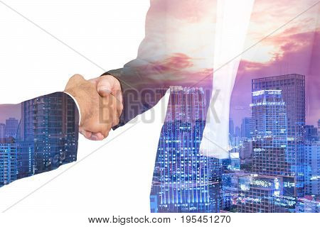 scene of businessman shakehand for commit on double exposure cityscape - can use to display or montage on product