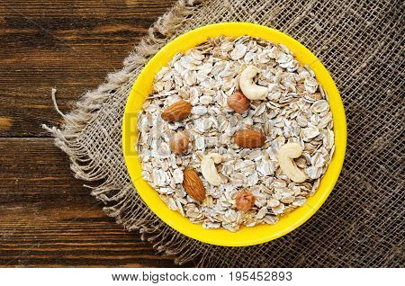 Muesli With Nuts (hazelnuts, Cashews, Almonds) . Muesli On A Wooden Table. Muesli Top View . Healthy