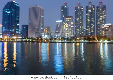 Night twilight blurred bokeh office builidng waterfront abstract background