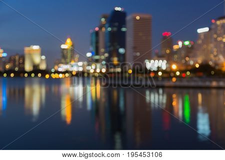 Reflection blurred bokeh light offce building at twilight abstract background