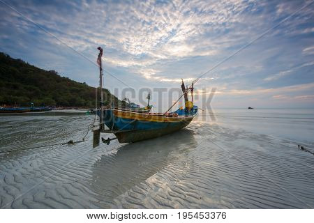 Fishing boat moored at sea after sunset near sunset.