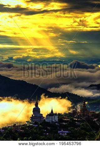 This temple Pha Son Kaew is public In PhetchabunThailand. This was taken at a scenic sunrise.The temple on the hilltop.The morning mist is beautiful just with tourists.