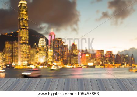 Opening wooden floor Blurred bokeh light Hong Kong business downtown light seafront abstract background